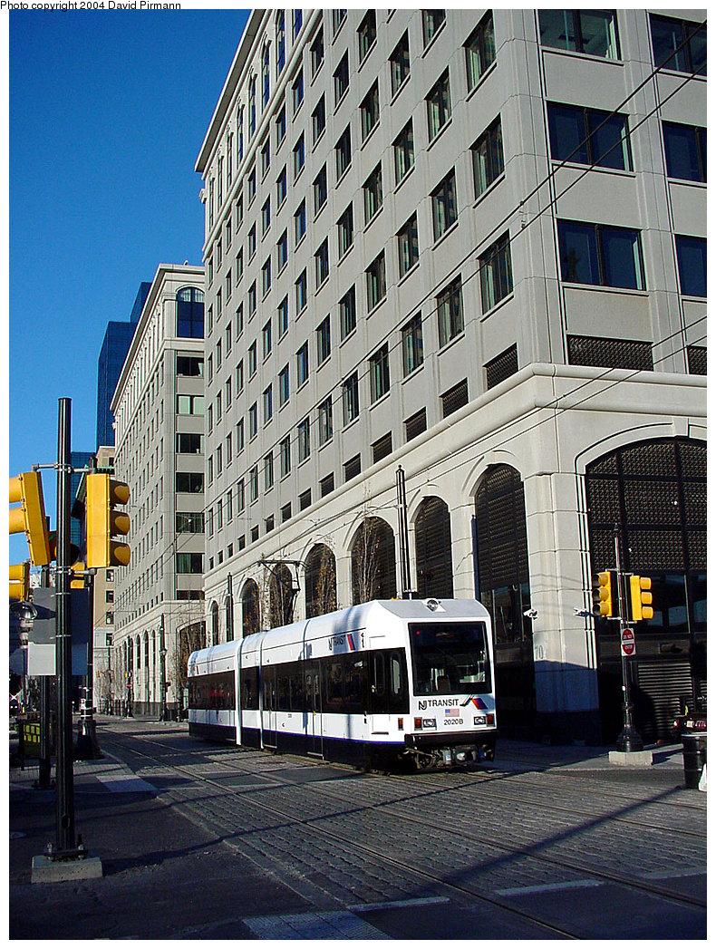 (345k, 790x1047)<br><b>Country:</b> United States<br><b>City:</b> Jersey City, NJ<br><b>System:</b> Hudson Bergen Light Rail<br><b>Location:</b> Exchange Place <br><b>Car:</b> NJT-HBLR LRV (Kinki-Sharyo, 1998-99)  2020 <br><b>Photo by:</b> David Pirmann<br><b>Date:</b> 11/11/2001<br><b>Viewed (this week/total):</b> 0 / 2857