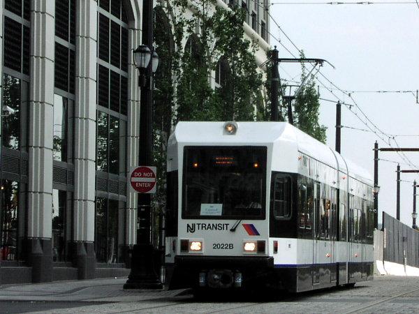 (79k, 600x450)<br><b>Country:</b> United States<br><b>City:</b> Jersey City, NJ<br><b>System:</b> Hudson Bergen Light Rail<br><b>Location:</b> Exchange Place <br><b>Car:</b> NJT-HBLR LRV (Kinki-Sharyo, 1998-99)  2022 <br><b>Photo by:</b> Trevor Logan<br><b>Date:</b> 7/24/2001<br><b>Viewed (this week/total):</b> 0 / 2687