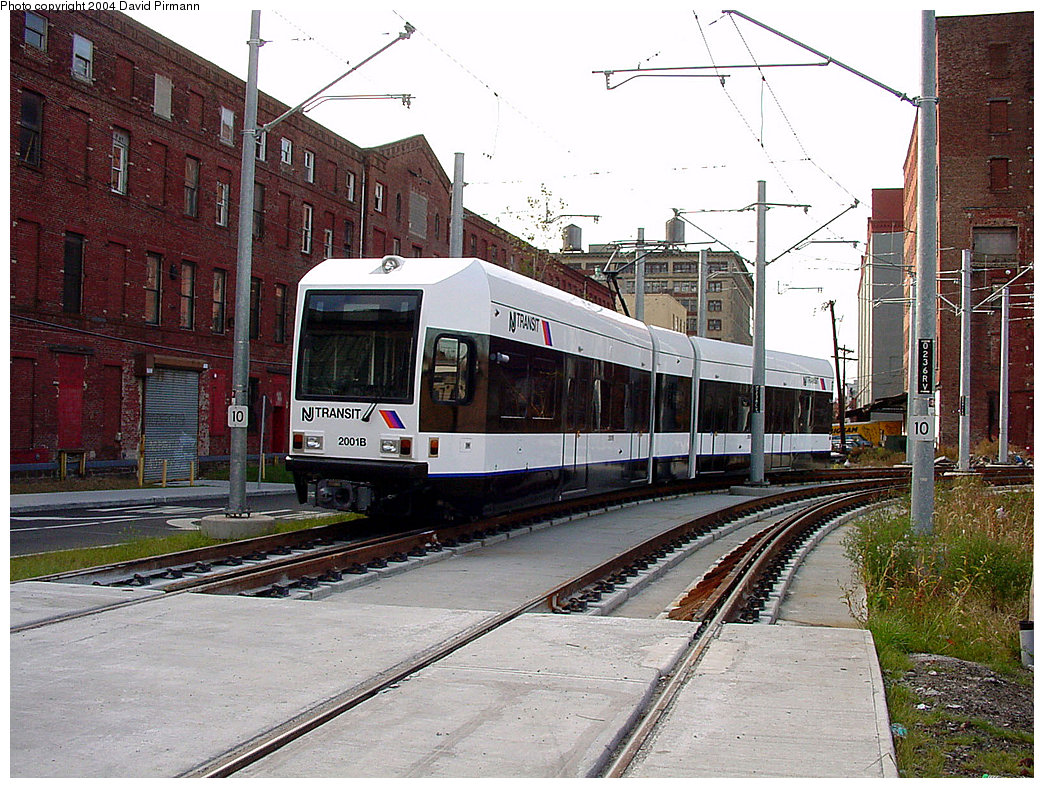 (301k, 1044x788)<br><b>Country:</b> United States<br><b>City:</b> Jersey City, NJ<br><b>System:</b> Hudson Bergen Light Rail<br><b>Location:</b> Harsimus Cove <br><b>Car:</b> NJT-HBLR LRV (Kinki-Sharyo, 1998-99)  2001 <br><b>Photo by:</b> David Pirmann<br><b>Date:</b> 11/12/2000<br><b>Notes:</b> Washington Blvd. grade crossing<br><b>Viewed (this week/total):</b> 0 / 2980