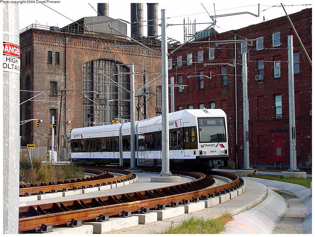(371k, 1044x788)<br><b>Country:</b> United States<br><b>City:</b> Jersey City, NJ<br><b>System:</b> Hudson Bergen Light Rail<br><b>Location:</b> Harsimus Cove <br><b>Car:</b> NJT-HBLR LRV (Kinki-Sharyo, 1998-99)  2001 <br><b>Photo by:</b> David Pirmann<br><b>Date:</b> 11/12/2000<br><b>Notes:</b> Curve south of Harsimus Cove station<br><b>Viewed (this week/total):</b> 0 / 3676