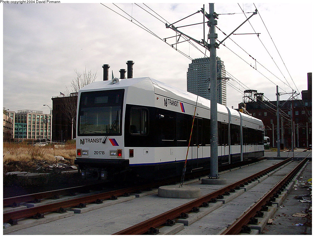 (244k, 1044x788)<br><b>Country:</b> United States<br><b>City:</b> Jersey City, NJ<br><b>System:</b> Hudson Bergen Light Rail<br><b>Location:</b> Harsimus Cove <br><b>Car:</b> NJT-HBLR LRV (Kinki-Sharyo, 1998-99)  2017 <br><b>Photo by:</b> David Pirmann<br><b>Date:</b> 11/12/2000<br><b>Notes:</b> 2nd St. grade crossing<br><b>Viewed (this week/total):</b> 1 / 2270