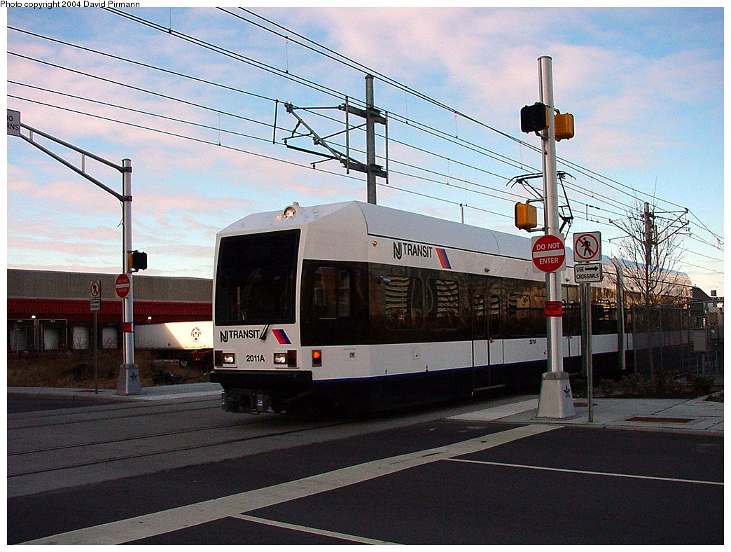 (286k, 1044x788)<br><b>Country:</b> United States<br><b>City:</b> Jersey City, NJ<br><b>System:</b> Hudson Bergen Light Rail<br><b>Location:</b> Harsimus Cove <br><b>Car:</b> NJT-HBLR LRV (Kinki-Sharyo, 1998-99)  2011 <br><b>Photo by:</b> David Pirmann<br><b>Date:</b> 11/12/2000<br><b>Notes:</b> 2nd St. grade crossing<br><b>Viewed (this week/total):</b> 1 / 2648