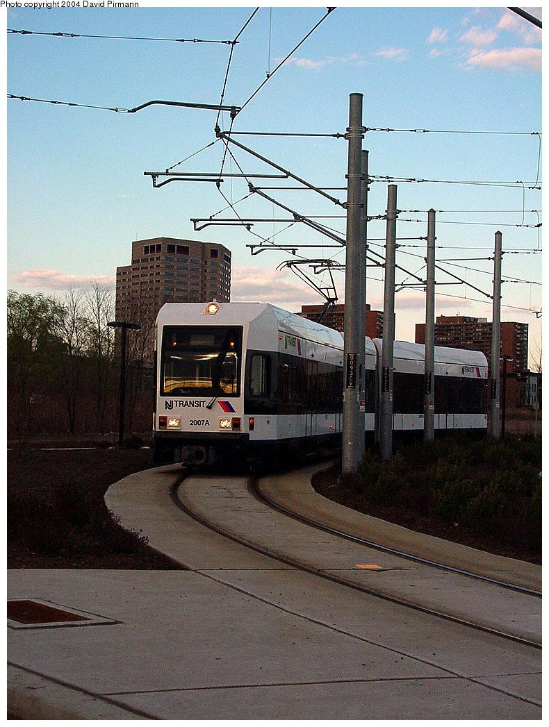 (267k, 790x1047)<br><b>Country:</b> United States<br><b>City:</b> Jersey City, NJ<br><b>System:</b> Hudson Bergen Light Rail<br><b>Location:</b> Jersey Avenue <br><b>Car:</b> NJT-HBLR LRV (Kinki-Sharyo, 1998-99)  2007 <br><b>Photo by:</b> David Pirmann<br><b>Date:</b> 3/26/2000<br><b>Viewed (this week/total):</b> 0 / 2838