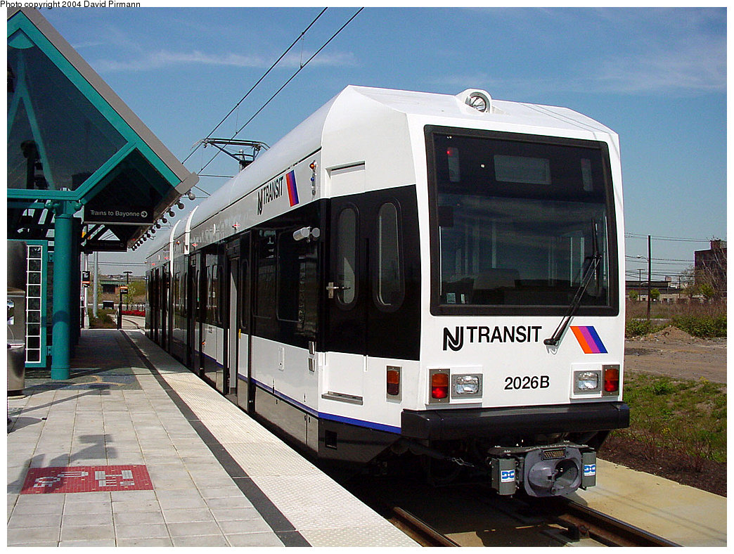 (269k, 1044x788)<br><b>Country:</b> United States<br><b>City:</b> Jersey City, NJ<br><b>System:</b> Hudson Bergen Light Rail<br><b>Location:</b> Jersey Avenue <br><b>Car:</b> NJT-HBLR LRV (Kinki-Sharyo, 1998-99)  2026 <br><b>Photo by:</b> David Pirmann<br><b>Date:</b> 4/29/2000<br><b>Viewed (this week/total):</b> 0 / 2719
