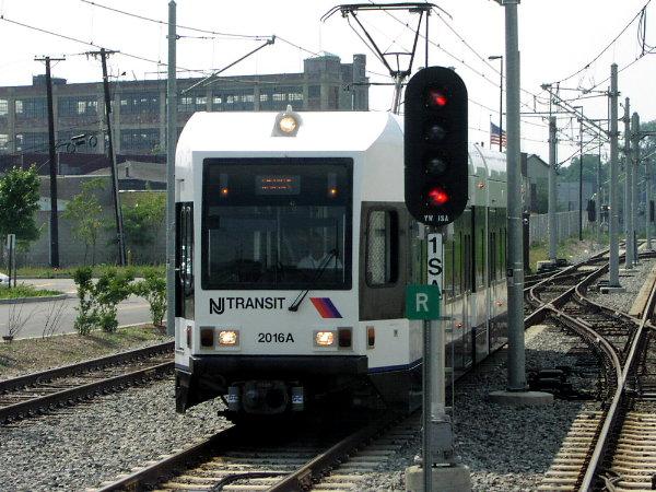 (93k, 600x450)<br><b>Country:</b> United States<br><b>City:</b> Jersey City, NJ<br><b>System:</b> Hudson Bergen Light Rail<br><b>Location:</b> Liberty State Park <br><b>Car:</b> NJT-HBLR LRV (Kinki-Sharyo, 1998-99)  2016 <br><b>Photo by:</b> Trevor Logan<br><b>Date:</b> 7/24/2001<br><b>Notes:</b> Approaching Liberty State Park station from Westside Branch Right-of-way<br><b>Viewed (this week/total):</b> 0 / 2977