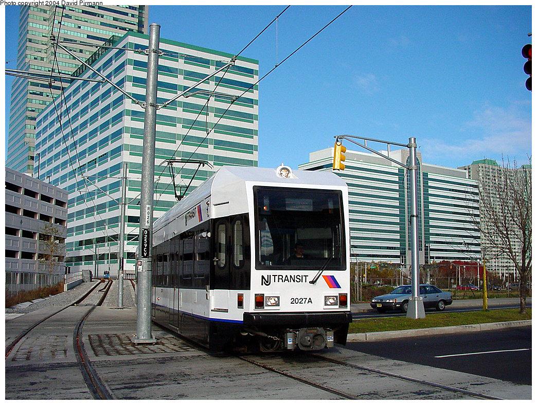 (351k, 1044x788)<br><b>Country:</b> United States<br><b>City:</b> Jersey City, NJ<br><b>System:</b> Hudson Bergen Light Rail<br><b>Location:</b> Pavonia/Newport <br><b>Car:</b> NJT-HBLR LRV (Kinki-Sharyo, 1998-99)  2027 <br><b>Photo by:</b> David Pirmann<br><b>Date:</b> 11/12/2000<br><b>Notes:</b> 6th St. grade crossing facing Newport<br><b>Viewed (this week/total):</b> 1 / 2945