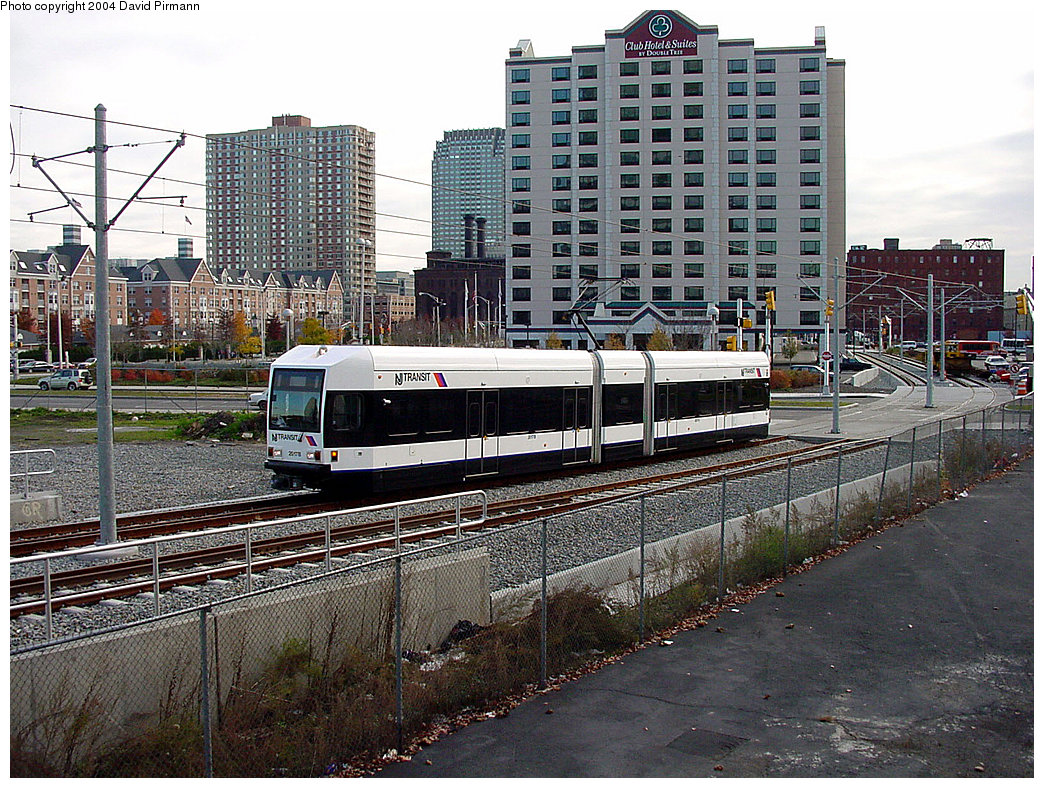 (339k, 1044x788)<br><b>Country:</b> United States<br><b>City:</b> Jersey City, NJ<br><b>System:</b> Hudson Bergen Light Rail<br><b>Location:</b> Pavonia/Newport <br><b>Car:</b> NJT-HBLR LRV (Kinki-Sharyo, 1998-99)  2017 <br><b>Photo by:</b> David Pirmann<br><b>Date:</b> 11/12/2000<br><b>Notes:</b> PRW alongside Newport parking deck<br><b>Viewed (this week/total):</b> 0 / 2753