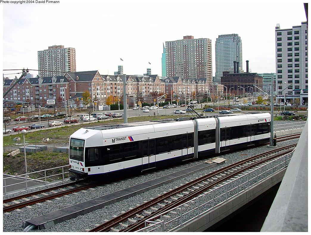 (344k, 1044x788)<br><b>Country:</b> United States<br><b>City:</b> Jersey City, NJ<br><b>System:</b> Hudson Bergen Light Rail<br><b>Location:</b> Pavonia/Newport <br><b>Car:</b> NJT-HBLR LRV (Kinki-Sharyo, 1998-99)  2017 <br><b>Photo by:</b> David Pirmann<br><b>Date:</b> 11/12/2000<br><b>Notes:</b> PRW alongside Newport parking deck<br><b>Viewed (this week/total):</b> 1 / 3220