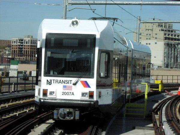 (74k, 600x450)<br><b>Country:</b> United States<br><b>City:</b> Jersey City, NJ<br><b>System:</b> Hudson Bergen Light Rail<br><b>Location:</b> Pavonia/Newport <br><b>Car:</b> NJT-HBLR LRV (Kinki-Sharyo, 1998-99)  2007 <br><b>Photo by:</b> Trevor Logan<br><b>Date:</b> 11/17/2001<br><b>Notes:</b> On Newport Viaduct leading to Hoboken<br><b>Viewed (this week/total):</b> 0 / 2932