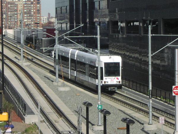 (82k, 600x450)<br><b>Country:</b> United States<br><b>City:</b> Jersey City, NJ<br><b>System:</b> Hudson Bergen Light Rail<br><b>Location:</b> Pavonia/Newport <br><b>Car:</b> NJT-HBLR LRV (Kinki-Sharyo, 1998-99)  2027 <br><b>Photo by:</b> Trevor Logan<br><b>Date:</b> 11/17/2001<br><b>Notes:</b> On Newport Viaduct near Newport station<br><b>Viewed (this week/total):</b> 0 / 3220