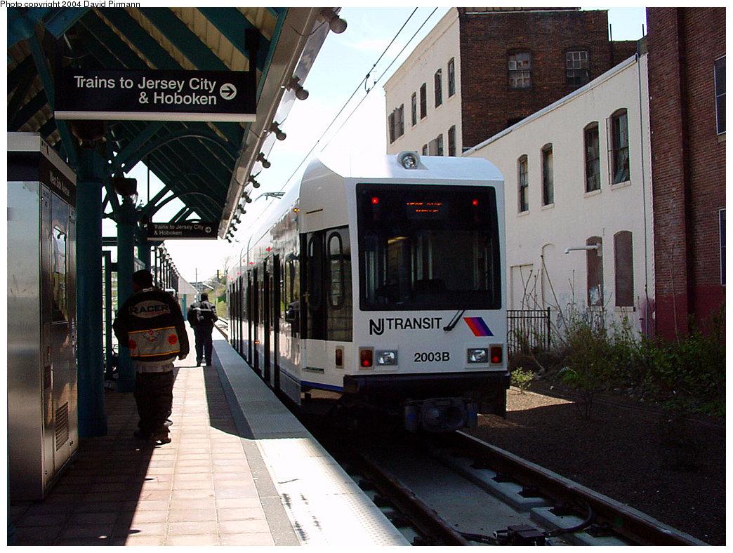 (254k, 1044x788)<br><b>Country:</b> United States<br><b>City:</b> Jersey City, NJ<br><b>System:</b> Hudson Bergen Light Rail<br><b>Location:</b> West Side Avenue <br><b>Car:</b> NJT-HBLR LRV (Kinki-Sharyo, 1998-99)  2003 <br><b>Photo by:</b> David Pirmann<br><b>Date:</b> 4/29/2000<br><b>Viewed (this week/total):</b> 0 / 3556