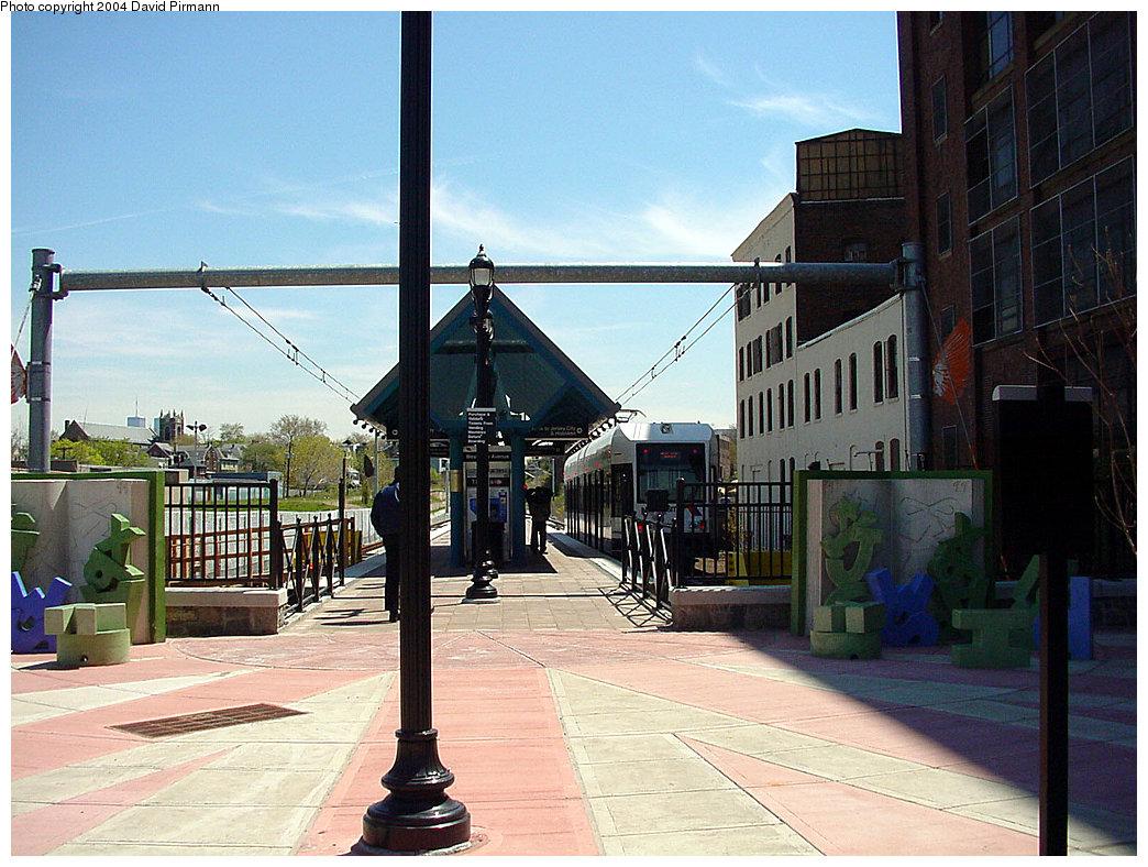 (263k, 1044x788)<br><b>Country:</b> United States<br><b>City:</b> Jersey City, NJ<br><b>System:</b> Hudson Bergen Light Rail<br><b>Location:</b> West Side Avenue <br><b>Photo by:</b> David Pirmann<br><b>Date:</b> 4/29/2000<br><b>Notes:</b> View of station plaza<br><b>Viewed (this week/total):</b> 0 / 3985