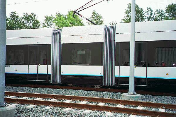 (53k, 600x400)<br><b>Country:</b> United States<br><b>City:</b> Jersey City, NJ<br><b>System:</b> Hudson Bergen Light Rail<br><b>Location:</b> HBLR Shops/Yard <br><b>Car:</b> NJT-HBLR LRV (Kinki-Sharyo, 1998-99)  2001 <br><b>Photo by:</b> Sidney Keyles<br><b>Date:</b> 6/5/1999<br><b>Notes:</b> Showing double articulation joint<br><b>Viewed (this week/total):</b> 1 / 2494