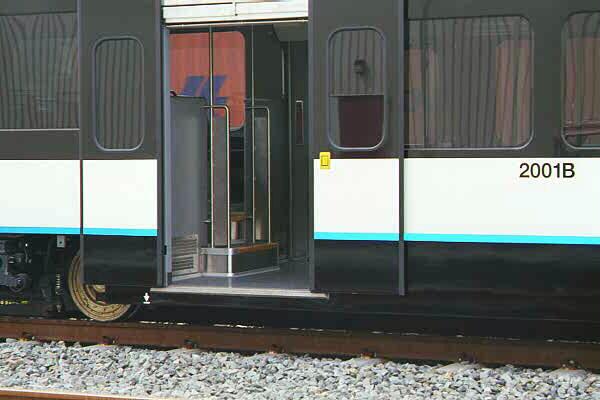 (67k, 600x400)<br><b>Country:</b> United States<br><b>City:</b> Jersey City, NJ<br><b>System:</b> Hudson Bergen Light Rail<br><b>Location:</b> HBLR Shops/Yard <br><b>Car:</b> NJT-HBLR LRV (Kinki-Sharyo, 1998-99)  2001 <br><b>Photo by:</b> Sidney Keyles<br><b>Date:</b> 6/5/1999<br><b>Notes:</b> Showing low-floor doorway<br><b>Viewed (this week/total):</b> 2 / 3222