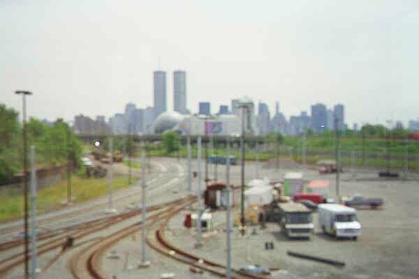 (40k, 600x400)<br><b>Country:</b> United States<br><b>City:</b> Jersey City, NJ<br><b>System:</b> Hudson Bergen Light Rail<br><b>Location:</b> HBLR Shops/Yard <br><b>Photo by:</b> Sidney Keyles<br><b>Date:</b> 6/5/1999<br><b>Notes:</b> North view from control tower showing area's proximity to new york city<br><b>Viewed (this week/total):</b> 1 / 3034