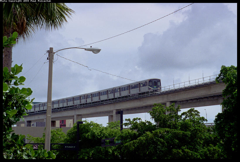 (82k, 820x553)<br><b>Country:</b> United States<br><b>City:</b> Miami, FL<br><b>System:</b> Miami Metrorail<br><b>Location:</b> Government Center <br><b>Photo by:</b> Paul Polischuk<br><b>Date:</b> 8/2000<br><b>Notes:</b> View from street of northbound train<br><b>Viewed (this week/total):</b> 0 / 4854