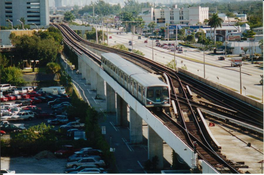 (103k, 900x597)<br><b>Country:</b> United States<br><b>City:</b> Miami, FL<br><b>System:</b> Miami Metrorail<br><b>Location:</b> Dadeland South <br><b>Photo by:</b> Bob Pickering<br><b>Date:</b> 1/1/1997<br><b>Notes:</b> Metrorail train approaching the end of the line at Kendall at Dadeland South station<br><b>Viewed (this week/total):</b> 4 / 7269