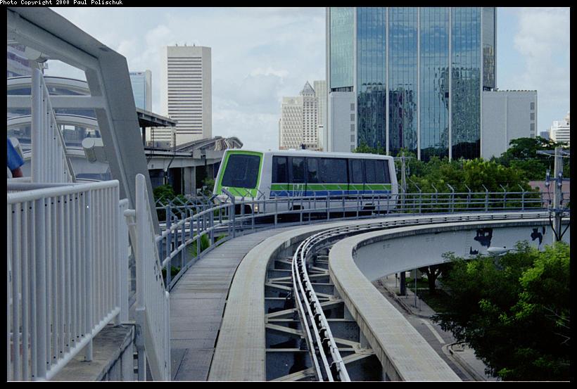 (95k, 820x553)<br><b>Country:</b> United States<br><b>City:</b> Miami, FL<br><b>System:</b> Miami Metromover<br><b>Location:</b> Brickell <br><b>Photo by:</b> Paul Polischuk<br><b>Date:</b> 8/2000<br><b>Notes:</b> Outbound Brickell train just north of Brickell Station.<br><b>Viewed (this week/total):</b> 0 / 4757