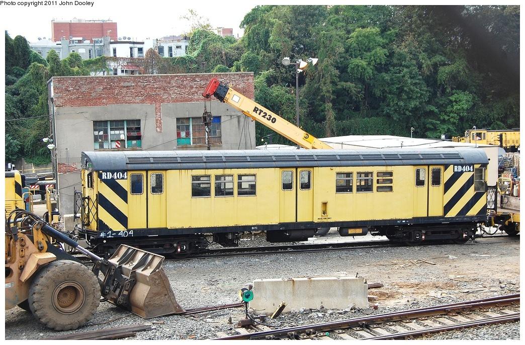 (461k, 1044x686)<br><b>Country:</b> United States<br><b>City:</b> New York<br><b>System:</b> New York City Transit<br><b>Location:</b> 36th Street Yard<br><b>Route:</b> Work Service<br><b>Car:</b> R-161 Rider Car (ex-R-33)  RD404 <br><b>Photo by:</b> John Dooley<br><b>Date:</b> 9/21/2011<br><b>Viewed (this week/total):</b> 1 / 1260