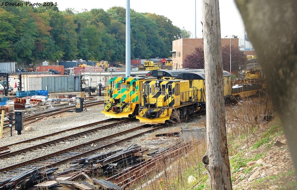 (462k, 1024x654)<br><b>Country:</b> United States<br><b>City:</b> New York<br><b>System:</b> New York City Transit<br><b>Location:</b> 36th Street Yard<br><b>Route:</b> Work Service<br><b>Car:</b> R-77 Locomotive  886 <br><b>Photo by:</b> John Dooley<br><b>Date:</b> 10/26/2011<br><b>Notes:</b> With Loco R-41 56<br><b>Viewed (this week/total):</b> 1 / 981