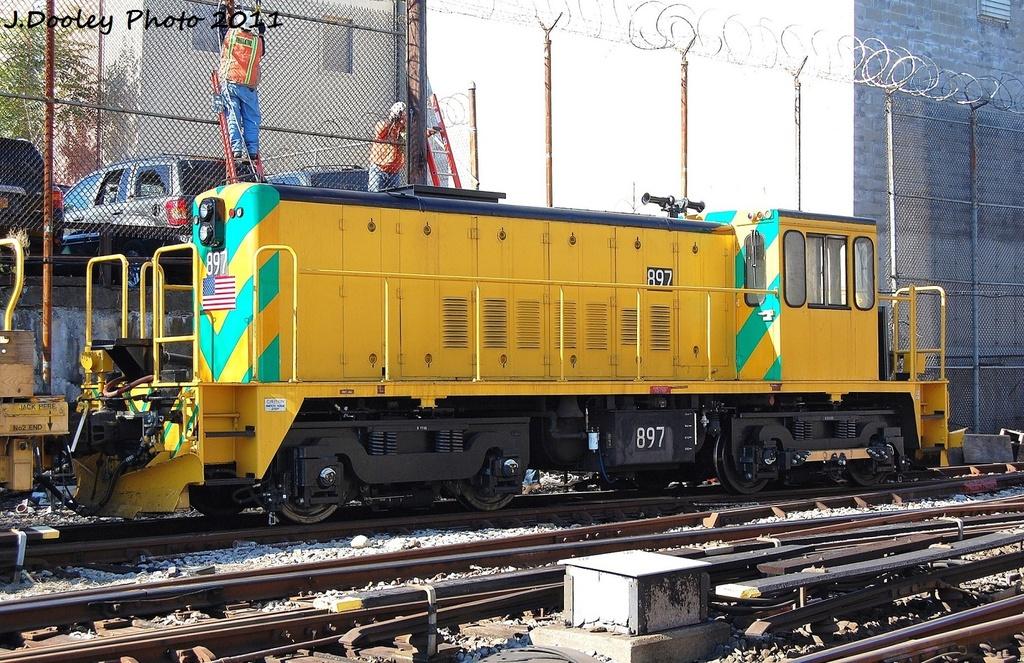 (416k, 1024x663)<br><b>Country:</b> United States<br><b>City:</b> New York<br><b>System:</b> New York City Transit<br><b>Location:</b> Westchester Yard<br><b>Car:</b> R-77 Locomotive  897 <br><b>Photo by:</b> John Dooley<br><b>Date:</b> 11/5/2011<br><b>Viewed (this week/total):</b> 0 / 657