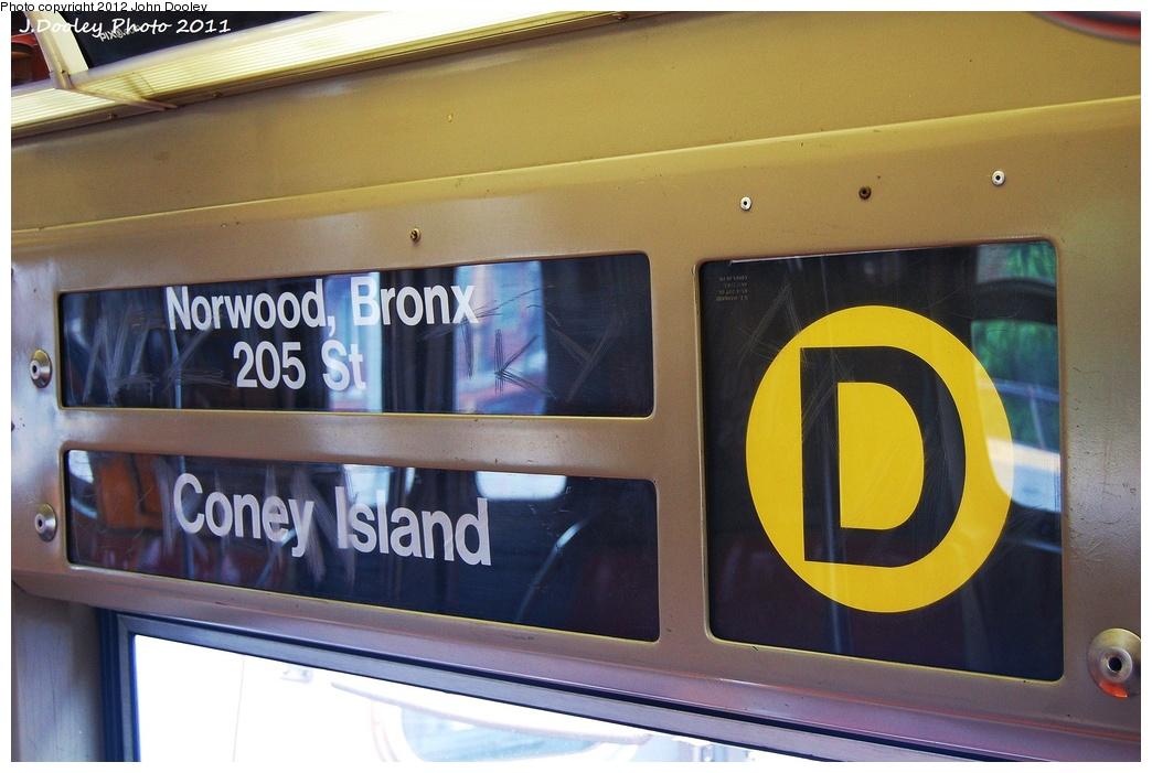 (293k, 1044x701)<br><b>Country:</b> United States<br><b>City:</b> New York<br><b>System:</b> New York City Transit<br><b>Route:</b> D<br><b>Car:</b> R-68 (Westinghouse-Amrail, 1986-1988)  Interior <br><b>Photo by:</b> John Dooley<br><b>Date:</b> 6/28/2011<br><b>Notes:</b> Note Yellow D sign.<br><b>Viewed (this week/total):</b> 3 / 948