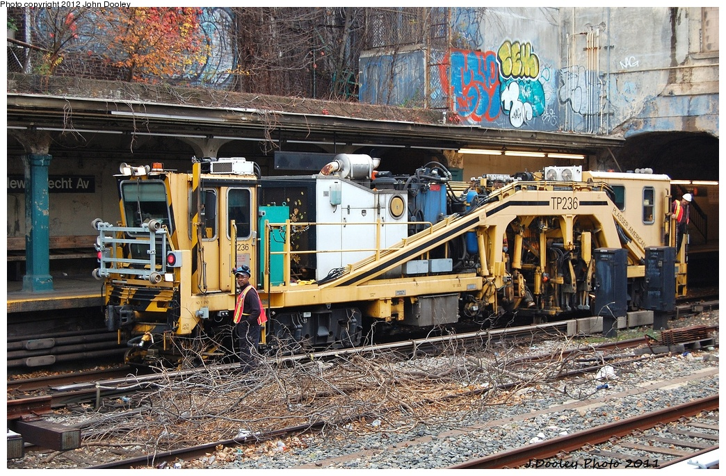 (481k, 1044x685)<br><b>Country:</b> United States<br><b>City:</b> New York<br><b>System:</b> New York City Transit<br><b>Line:</b> BMT Sea Beach Line<br><b>Location:</b> New Utrecht Avenue <br><b>Route:</b> Work Service<br><b>Car:</b> Ballast Tamper TP236 <br><b>Photo by:</b> John Dooley<br><b>Date:</b> 11/27/2011<br><b>Viewed (this week/total):</b> 1 / 1007