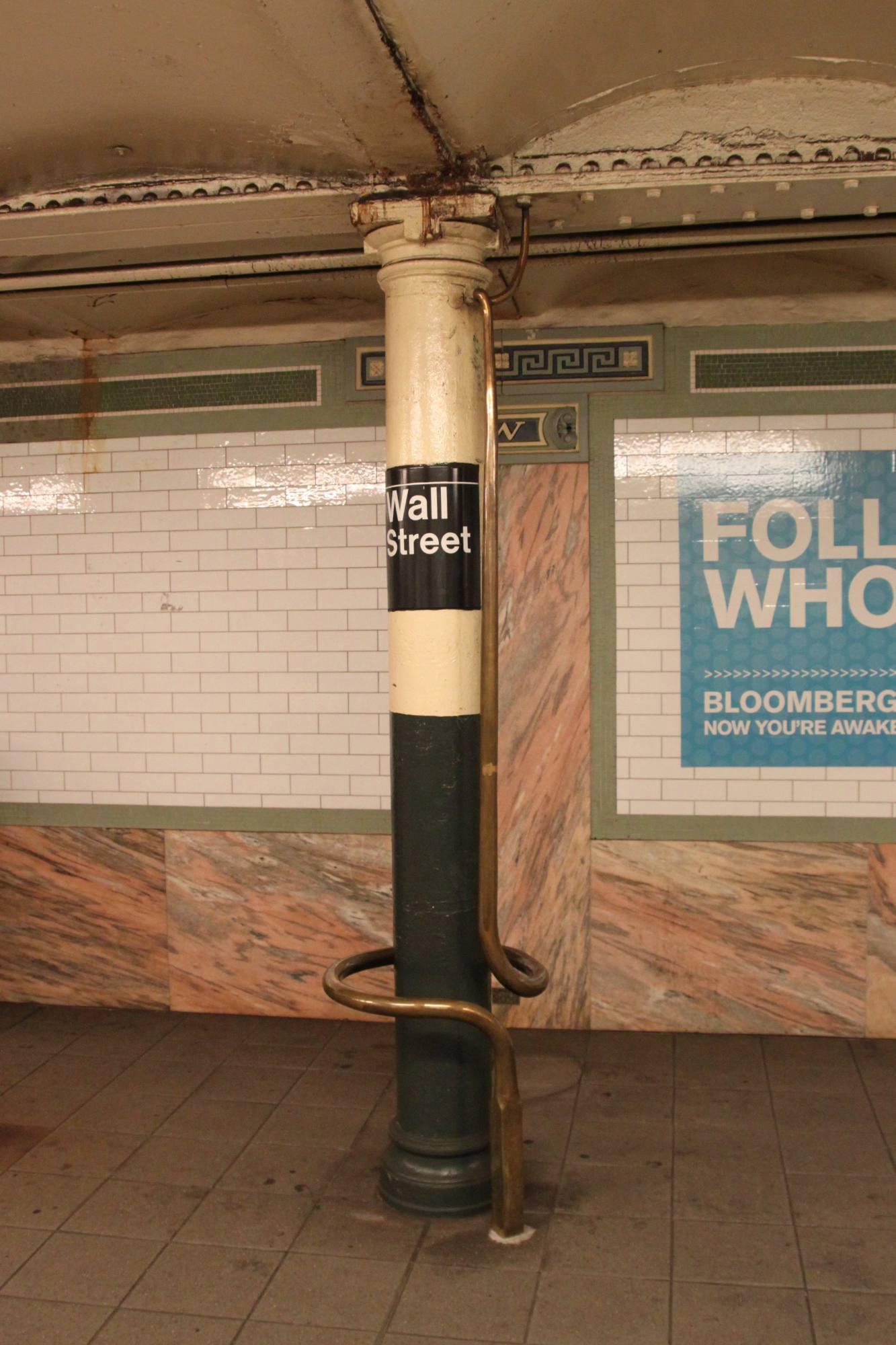 (241k, 1333x2000)<br><b>Country:</b> United States<br><b>City:</b> New York<br><b>System:</b> New York City Transit<br><b>Line:</b> IRT East Side Line<br><b>Location:</b> Wall Street <br><b>Photo by:</b> Robbie Rosenfeld<br><b>Date:</b> 9/25/2011<br><b>Artwork:</b> <i>Lariat Seat Loops</i>, James Garvey.<br><b>Viewed (this week/total):</b> 0 / 1503