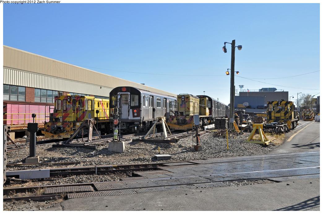 (399k, 1044x691)<br><b>Country:</b> United States<br><b>City:</b> New York<br><b>System:</b> New York City Transit<br><b>Location:</b> Westchester Yard<br><b>Car:</b> R-77E Locomotive  E05 <br><b>Photo by:</b> Zach Summer<br><b>Date:</b> 11/5/2011<br><b>Notes:</b> With R142A 7421, R77E 07, R77 890<br><b>Viewed (this week/total):</b> 1 / 783