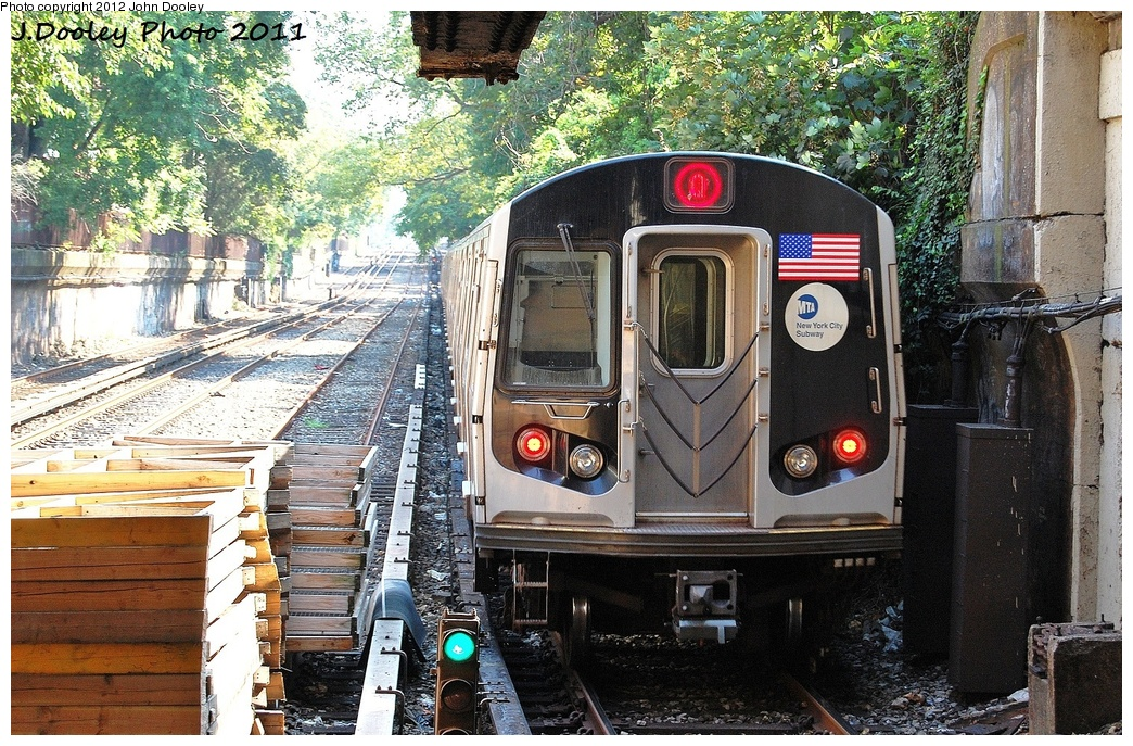 (464k, 1044x687)<br><b>Country:</b> United States<br><b>City:</b> New York<br><b>System:</b> New York City Transit<br><b>Line:</b> BMT Brighton Line<br><b>Location:</b> Newkirk Plaza (fmrly Newkirk Ave.) <br><b>Route:</b> Q<br><b>Car:</b> R-160B (Kawasaki, 2005-2008)  8722 <br><b>Photo by:</b> John Dooley<br><b>Date:</b> 9/12/2011<br><b>Viewed (this week/total):</b> 1 / 1039