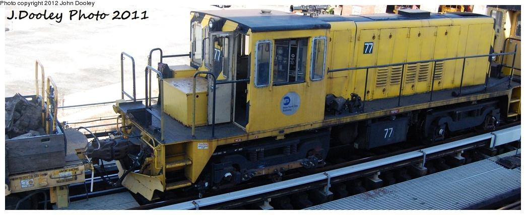 (234k, 1044x427)<br><b>Country:</b> United States<br><b>City:</b> New York<br><b>System:</b> New York City Transit<br><b>Location:</b> Coney Island Yard<br><b>Route:</b> Work Service<br><b>Car:</b> R-52 Locomotive  77 <br><b>Photo by:</b> John Dooley<br><b>Date:</b> 10/9/2011<br><b>Notes:</b> Avenue X yard leads.<br><b>Viewed (this week/total):</b> 1 / 450