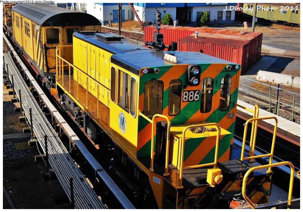 (482k, 1044x730)<br><b>Country:</b> United States<br><b>City:</b> New York<br><b>System:</b> New York City Transit<br><b>Location:</b> Coney Island Yard<br><b>Route:</b> Work Service<br><b>Car:</b> R-77 Locomotive  886 <br><b>Photo by:</b> John Dooley<br><b>Date:</b> 10/9/2011<br><b>Notes:</b> Avenue X yard leads.<br><b>Viewed (this week/total):</b> 2 / 507