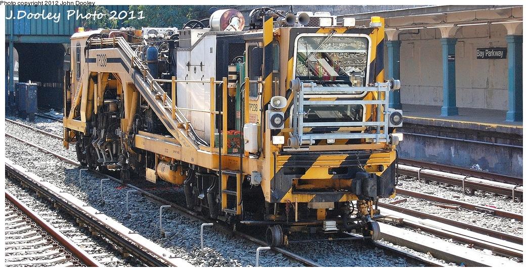 (407k, 1044x538)<br><b>Country:</b> United States<br><b>City:</b> New York<br><b>System:</b> New York City Transit<br><b>Line:</b> BMT Sea Beach Line<br><b>Location:</b> Bay Parkway (22nd Avenue) <br><b>Route:</b> Work Service<br><b>Car:</b> Ballast Tamper TP238 <br><b>Photo by:</b> John Dooley<br><b>Date:</b> 10/8/2011<br><b>Viewed (this week/total):</b> 0 / 1262