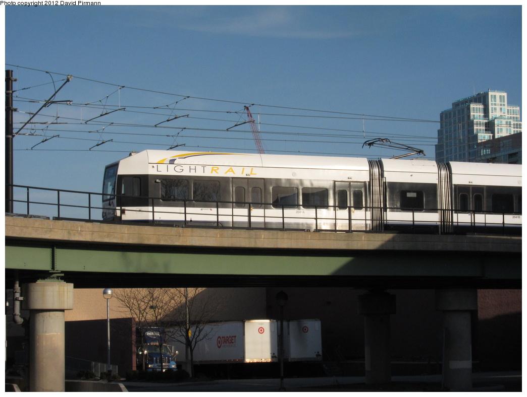 (246k, 1044x788)<br><b>Country:</b> United States<br><b>City:</b> Jersey City, NJ<br><b>System:</b> Hudson Bergen Light Rail<br><b>Location:</b> Between Newport & Hoboken <br><b>Car:</b> NJT-HBLR LRV (Kinki-Sharyo, 1998-99)  2041 <br><b>Photo by:</b> David Pirmann<br><b>Date:</b> 3/7/2012<br><b>Viewed (this week/total):</b> 1 / 392