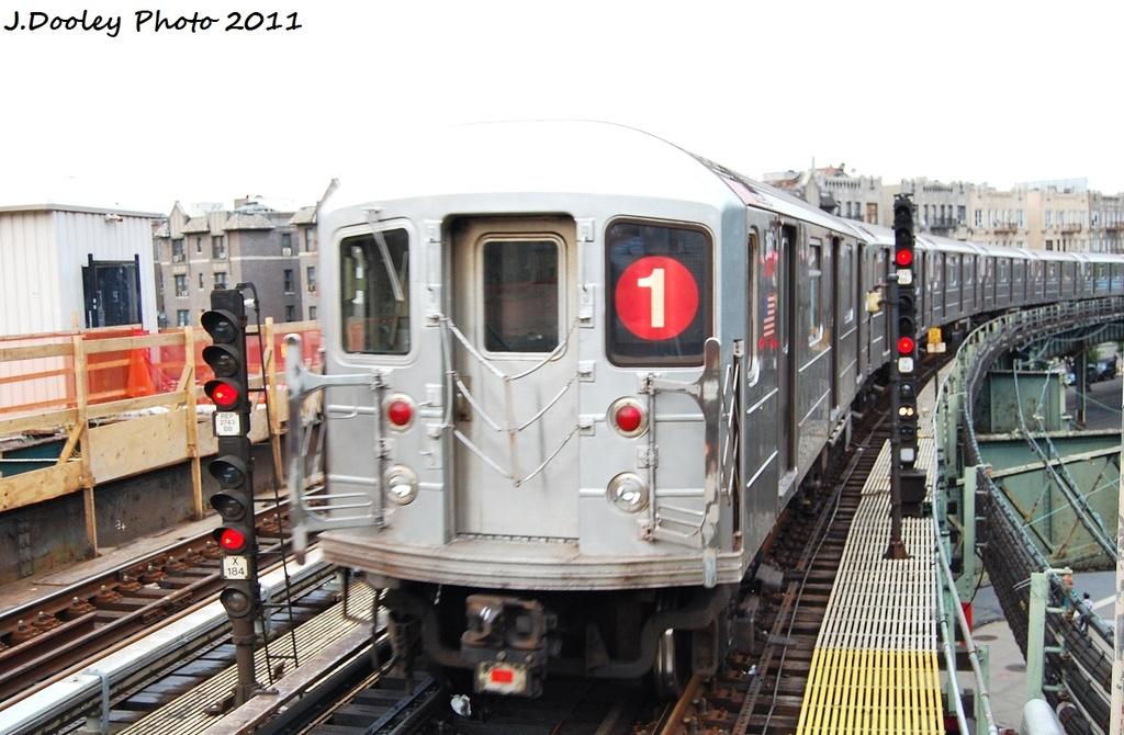 (295k, 1024x670)<br><b>Country:</b> United States<br><b>City:</b> New York<br><b>System:</b> New York City Transit<br><b>Line:</b> IRT West Side Line<br><b>Location:</b> Dyckman Street <br><b>Route:</b> 1<br><b>Car:</b> R-62A (Bombardier, 1984-1987)  1888 <br><b>Photo by:</b> John Dooley<br><b>Date:</b> 9/22/2011<br><b>Viewed (this week/total):</b> 2 / 1025