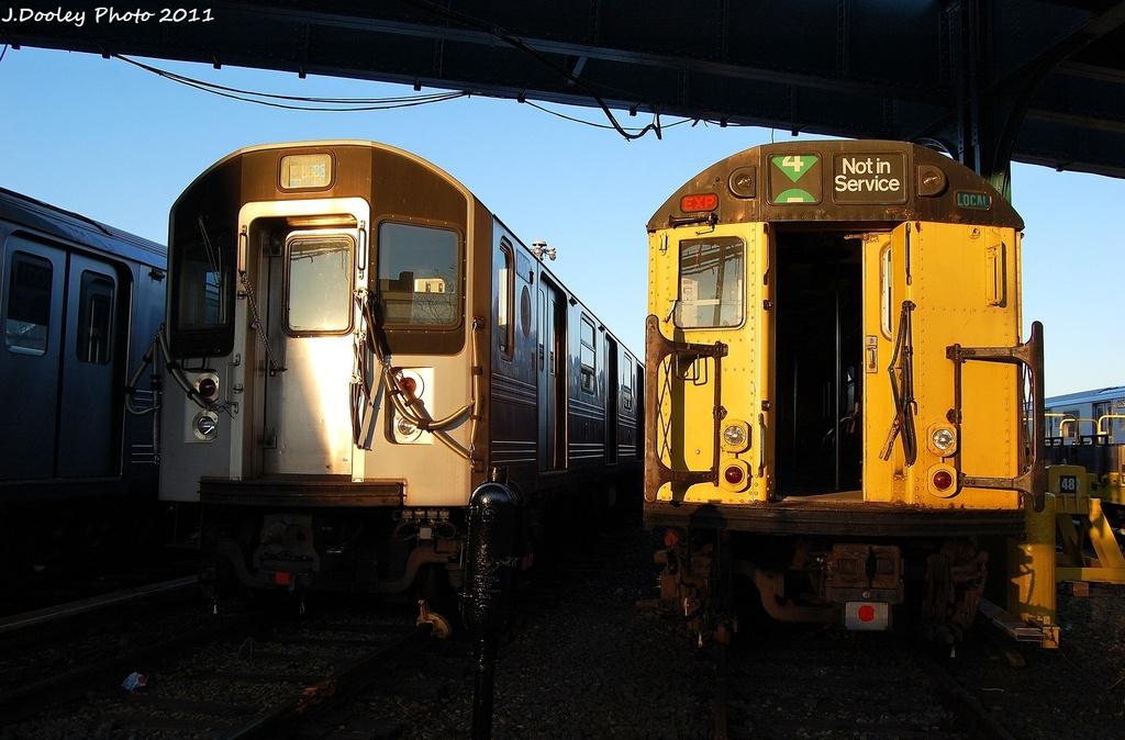 (293k, 1024x674)<br><b>Country:</b> United States<br><b>City:</b> New York<br><b>System:</b> New York City Transit<br><b>Location:</b> 239th Street Yard<br><b>Car:</b> R-33 World's Fair (St. Louis, 1963-64)  <br><b>Photo by:</b> John Dooley<br><b>Date:</b> 12/8/2011<br><b>Notes:</b> With R-110A 8001<br><b>Viewed (this week/total):</b> 1 / 1255
