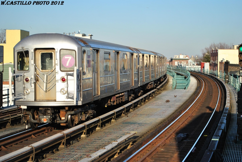 (332k, 1024x687)<br><b>Country:</b> United States<br><b>City:</b> New York<br><b>System:</b> New York City Transit<br><b>Line:</b> IRT Flushing Line<br><b>Location:</b> 103rd Street/Corona Plaza <br><b>Route:</b> 7<br><b>Car:</b> R-62A (Bombardier, 1984-1987)  1696 <br><b>Photo by:</b> Wilfredo Castillo<br><b>Date:</b> 3/6/2012<br><b>Viewed (this week/total):</b> 1 / 1139