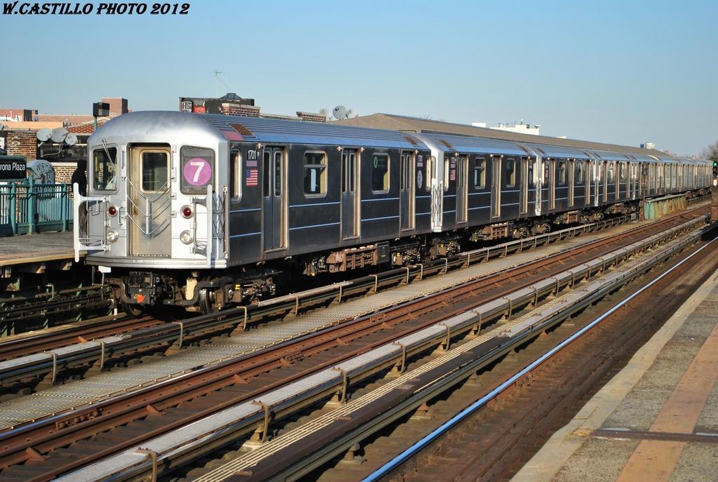 (338k, 1024x687)<br><b>Country:</b> United States<br><b>City:</b> New York<br><b>System:</b> New York City Transit<br><b>Line:</b> IRT Flushing Line<br><b>Location:</b> 103rd Street/Corona Plaza <br><b>Route:</b> 7<br><b>Car:</b> R-62A (Bombardier, 1984-1987)  1701 <br><b>Photo by:</b> Wilfredo Castillo<br><b>Date:</b> 3/6/2012<br><b>Viewed (this week/total):</b> 0 / 1106