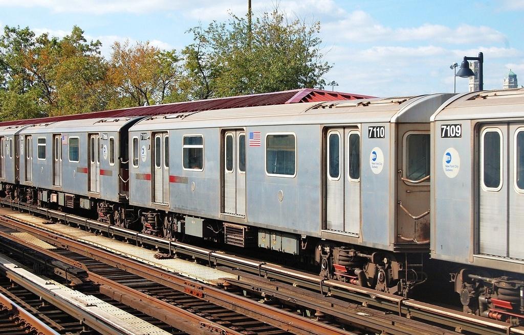 (397k, 1024x656)<br><b>Country:</b> United States<br><b>City:</b> New York<br><b>System:</b> New York City Transit<br><b>Line:</b> IRT Woodlawn Line<br><b>Location:</b> Bedford Park Boulevard <br><b>Route:</b> 4<br><b>Car:</b> R-142 (Option Order, Bombardier, 2002-2003)  7110 <br><b>Photo by:</b> John Dooley<br><b>Date:</b> 10/23/2011<br><b>Viewed (this week/total):</b> 2 / 902