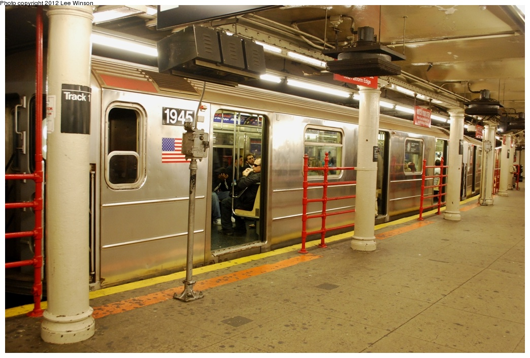 (297k, 1044x705)<br><b>Country:</b> United States<br><b>City:</b> New York<br><b>System:</b> New York City Transit<br><b>Line:</b> IRT Times Square-Grand Central Shuttle<br><b>Location:</b> Times Square <br><b>Route:</b> S<br><b>Car:</b> R-62A (Bombardier, 1984-1987)  1945 <br><b>Photo by:</b> Lee Winson<br><b>Date:</b> 3/18/2012<br><b>Notes:</b> 42nd-Times Square shuttle platform, #1945 (west end of train).<br><b>Viewed (this week/total):</b> 3 / 1086