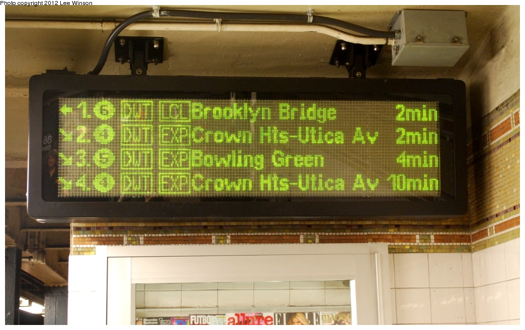 (282k, 1044x658)<br><b>Country:</b> United States<br><b>City:</b> New York<br><b>System:</b> New York City Transit<br><b>Line:</b> IRT East Side Line<br><b>Location:</b> 86th Street <br><b>Photo by:</b> Lee Winson<br><b>Date:</b> 3/18/2012<br><b>Notes:</b> IRT Lexington Ave, 86th Street downtown, local platform, waiting time sign.  Arrows point to appropriate platform for train. <br><b>Viewed (this week/total):</b> 0 / 1652