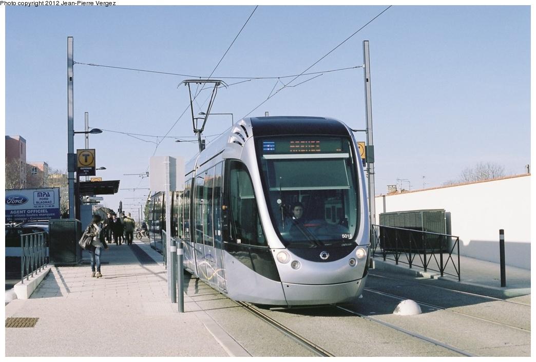 (220k, 1044x705)<br><b>Country:</b> France<br><b>City:</b> Toulouse<br><b>System:</b> Toulouse Metro (Operator: Tisseo Réseau Urbain)<br><b>Line:</b> Tram Ligne E <br><b>Location:</b> Guyenne <br><b>Car:</b> Citadis Low-Floor Type 302 (Alstom, 2009)  5018 <br><b>Photo by:</b> Jean-Pierre Vergez<br><b>Date:</b> 2/28/2012<br><b>Viewed (this week/total):</b> 3 / 507