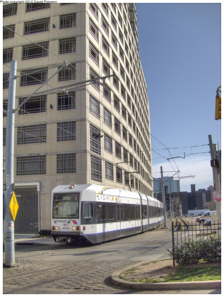(348k, 787x1044)<br><b>Country:</b> United States<br><b>City:</b> Jersey City, NJ<br><b>System:</b> Hudson Bergen Light Rail<br><b>Location:</b> 6th St. Grade Crossing <br><b>Car:</b> NJT-HBLR LRV (Kinki-Sharyo, 1998-99)  2032 <br><b>Photo by:</b> David Pirmann<br><b>Date:</b> 3/14/2012<br><b>Viewed (this week/total):</b> 0 / 355