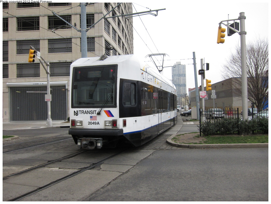(325k, 1044x788)<br><b>Country:</b> United States<br><b>City:</b> Jersey City, NJ<br><b>System:</b> Hudson Bergen Light Rail<br><b>Location:</b> 6th St. Grade Crossing <br><b>Car:</b> NJT-HBLR LRV (Kinki-Sharyo, 1998-99)  2049 <br><b>Photo by:</b> David Pirmann<br><b>Date:</b> 3/18/2012<br><b>Viewed (this week/total):</b> 0 / 468