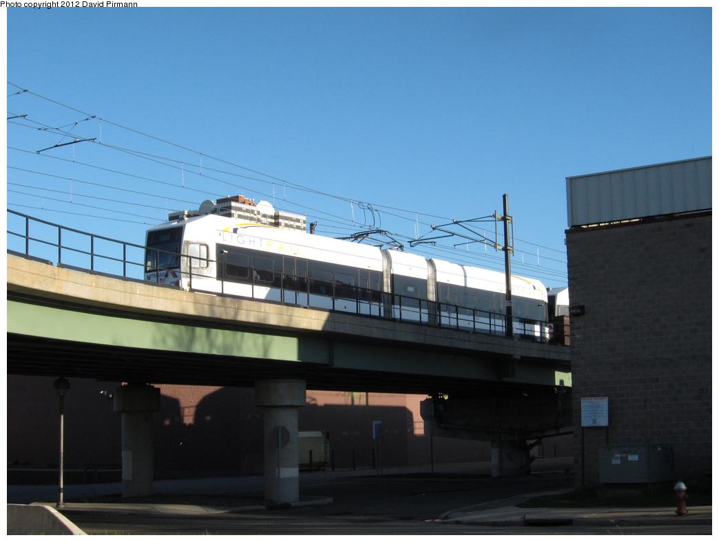(232k, 1044x788)<br><b>Country:</b> United States<br><b>City:</b> Jersey City, NJ<br><b>System:</b> Hudson Bergen Light Rail<br><b>Location:</b> Between Newport & Hoboken <br><b>Car:</b> NJT-HBLR LRV (Kinki-Sharyo, 1998-99)  2004 <br><b>Photo by:</b> David Pirmann<br><b>Date:</b> 4/2/2012<br><b>Viewed (this week/total):</b> 0 / 331