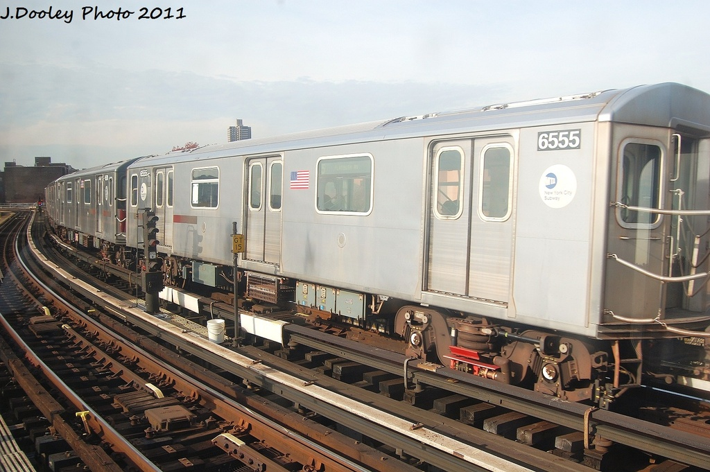 (319k, 1024x681)<br><b>Country:</b> United States<br><b>City:</b> New York<br><b>System:</b> New York City Transit<br><b>Line:</b> IRT White Plains Road Line<br><b>Location:</b> East 180th Street <br><b>Route:</b> 5<br><b>Car:</b> R-142 (Primary Order, Bombardier, 1999-2002)  6555 <br><b>Photo by:</b> John Dooley<br><b>Date:</b> 11/14/2011<br><b>Viewed (this week/total):</b> 1 / 897