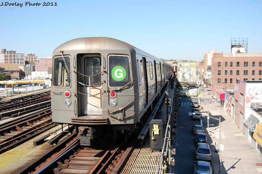 (326k, 1024x681)<br><b>Country:</b> United States<br><b>City:</b> New York<br><b>System:</b> New York City Transit<br><b>Line:</b> BMT Culver Line<br><b>Location:</b> Ditmas Avenue <br><b>Route:</b> G<br><b>Car:</b> R-68 (Westinghouse-Amrail, 1986-1988)  2910 <br><b>Photo by:</b> John Dooley<br><b>Date:</b> 10/9/2011<br><b>Viewed (this week/total):</b> 0 / 890