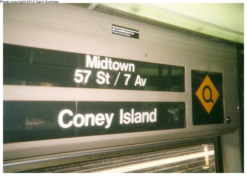 (229k, 820x584)<br><b>Country:</b> United States<br><b>City:</b> New York<br><b>System:</b> New York City Transit<br><b>Route:</b> Q<br><b>Car:</b> R-68 (Westinghouse-Amrail, 1986-1988)  Interior <br><b>Photo by:</b> Zach Summer<br><b>Date:</b> 7/22/2001<br><b>Notes:</b> New (Q) Local Rollsign using the original diamond-Q sign. First Day of Broadway Express/Brighton Local (Q) Service<br><b>Viewed (this week/total):</b> 0 / 945
