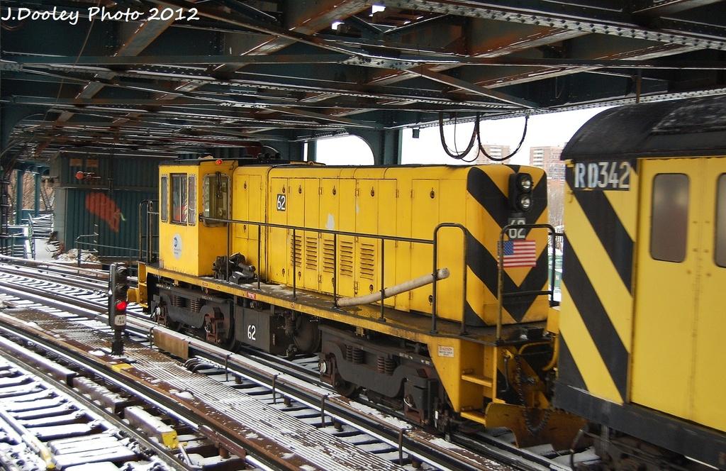 (373k, 1024x664)<br><b>Country:</b> United States<br><b>City:</b> New York<br><b>System:</b> New York City Transit<br><b>Line:</b> BMT Culver Line<br><b>Location:</b> West 8th Street <br><b>Route:</b> Work Service<br><b>Car:</b> R-43 Locomotive  62 <br><b>Photo by:</b> John Dooley<br><b>Date:</b> 1/21/2012<br><b>Viewed (this week/total):</b> 0 / 919
