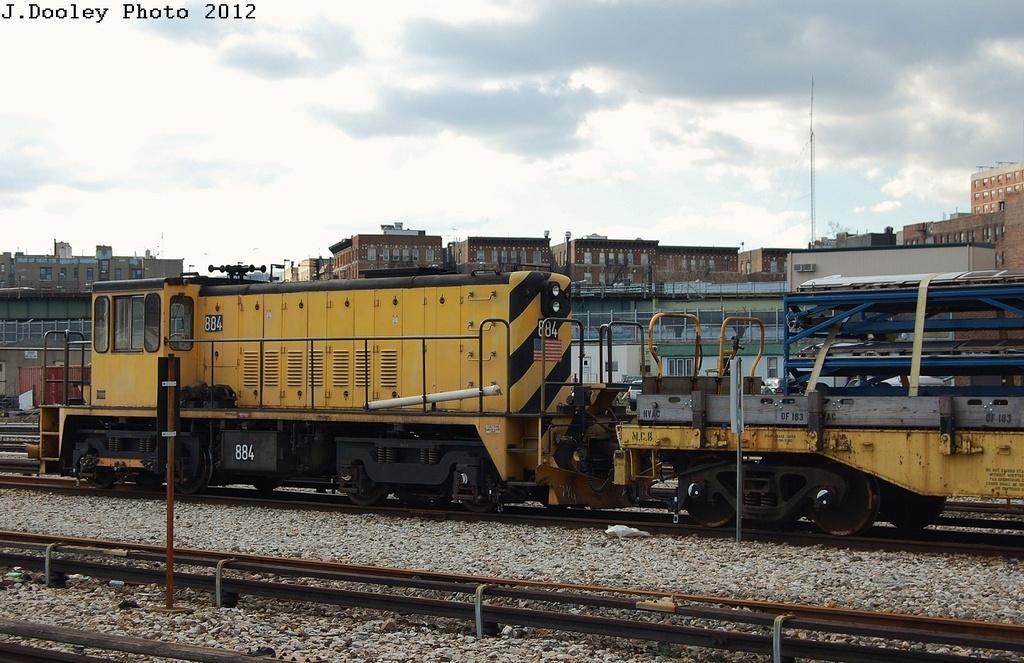 (324k, 1024x663)<br><b>Country:</b> United States<br><b>City:</b> New York<br><b>System:</b> New York City Transit<br><b>Location:</b> 207th Street Yard<br><b>Route:</b> Work Service<br><b>Car:</b> R-77 Locomotive  884 <br><b>Photo by:</b> John Dooley<br><b>Date:</b> 2/1/2012<br><b>Viewed (this week/total):</b> 0 / 384